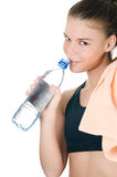 The sports girl with a towel and a water bottle Royalty Free Stock Photo