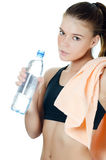 The sports girl with a towel and a water bottle Royalty Free Stock Image