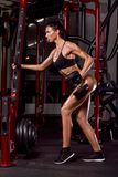 Sports girl training in gym royalty free stock photo