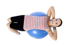 Sports girl. Young woman in a sports suit is engaged in fitness. pilates ball . looking at camera Stock Photography