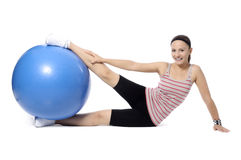 Sports girl. Young woman in a sports suit is engaged in fitness. pilates ball . looking at camera Stock Photo