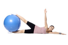 Sports girl. Young woman in a sports suit is engaged in fitness. pilates ball . looking at camera Stock Images