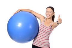 Sports girl. Young woman in a sports suit is engaged in fitness. pilates ball . looking at camera Stock Photos