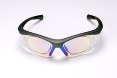 Sports glasses. In a white background Royalty Free Stock Photos