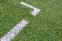 Sports grass. White lines on a soccer field. The lines serve as a marker for the space the coach may enter stock images