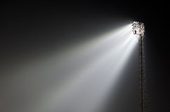 Sports ground floodlights. Stanchion supported sports ground floodlights lit up at night Royalty Free Stock Image
