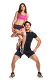 Sports guy holds on shoulder a girl on a white Royalty Free Stock Photo