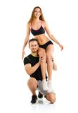 Sports guy holds on shoulder a girl on a white Stock Photography