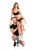 Sports guy holds on shoulder a girl on a white Stock Image