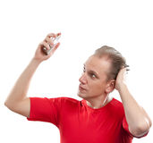 The sports guy spraying fragrance perfume. Sports man spraying fragrance perfume Royalty Free Stock Photography