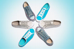 Sports gym shoes stand around on a light background Royalty Free Stock Photo