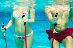 Sports and gymnastics under water in swimming pool Stock Photos