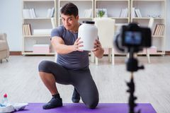 The sports and health blogger recording video in sport concept. Sports and health blogger recording video in sport concept Royalty Free Stock Image