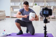 The sports and health blogger recording video in sport concept. Sports and health blogger recording video in sport concept Stock Image