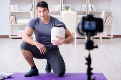 The sports and health blogger recording video in sport concept. Sports and health blogger recording video in sport concept Royalty Free Stock Images