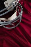 Sports helmet on jersey. Sports helmet on red jersey Royalty Free Stock Images