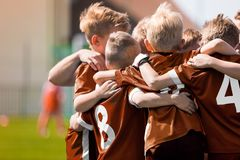 Free Sports Huddle; Children Sports Soccer Team. Kids Celebrating Football Victory. Winning Youth Boys Soccer Team Royalty Free Stock Photo - 146051325