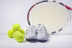 Sports Images Concepts: Tennis Raquet, Tennis Balls and Trainers. Against gray. Horizontal Image royalty free stock photos