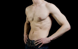 Sports inflated body of a white man on a black. Background Royalty Free Stock Photography