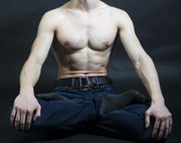 Sports inflated body of a white man on a black. Background Royalty Free Stock Image