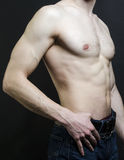 Sports inflated body of a white man on a black. Background Stock Photography