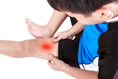 Sports injure. Asian child cyclist injured at thigh. Isolated on Royalty Free Stock Photography