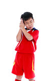 Sports injury. Asian boy have a headache. Isolated on white back royalty free stock image