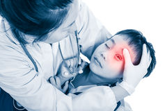 Sports injury. Doctor give first aid at child`s eye with a bruis Stock Image