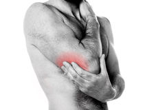 Sports injury - Pain in the elbow. Man holding his elbow in pain Royalty Free Stock Photos