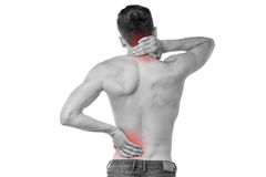 Sports injury pain towards back. Young man having neck and backache Stock Images