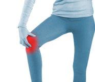 Sports injury - woman having pain in his knee making massage. Royalty Free Stock Photo