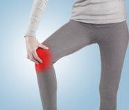 Sports injury - woman having pain in his knee making massage. Royalty Free Stock Image