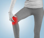 Sports injury - woman having pain in his knee making massage. Stock Images