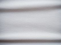 Sports jersey fabric texture background. White sports jersey fabric texture background Royalty Free Stock Images