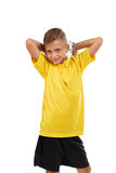 Sports kid isolated on a white background. Cute boy with a soccrr ball. Young football player. Active childhood concept. A schoolboy in sportswear posing with a stock photos