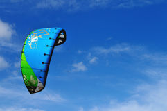 Sports kite in the sky. A kite-surfing kite in blue sunny sky Royalty Free Stock Photos