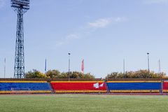 Sports large stadium with green artificial grass stock photo
