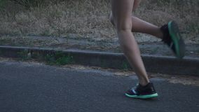 Sports legs of a young girl on a run stock footage