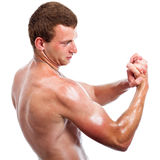 Sports man biceps Royalty Free Stock Photos