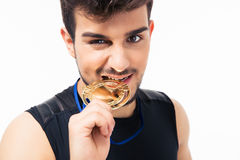 Sports man biting medal Royalty Free Stock Photos
