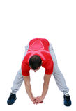 Sports man doing physical exercise for stretching Royalty Free Stock Image