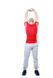 Sports man doing physical exercise for stretching Stock Images