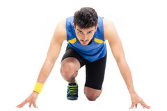 Sports man getting ready to run Stock Images