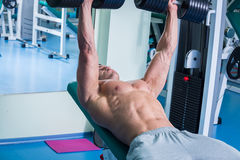 Sports man in the gym Royalty Free Stock Photos