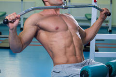 Sports man in the gym Royalty Free Stock Image