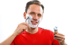 The sports man has a shave- with the razor and a s Royalty Free Stock Photo