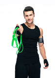 Sports man holding skipping rope Royalty Free Stock Photo