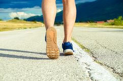 Sports man jogging in nature. Close up stock image