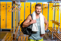 Sports man in the locker room Royalty Free Stock Image
