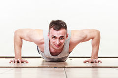 Sports man making pushups,. Care about health and body Royalty Free Stock Image